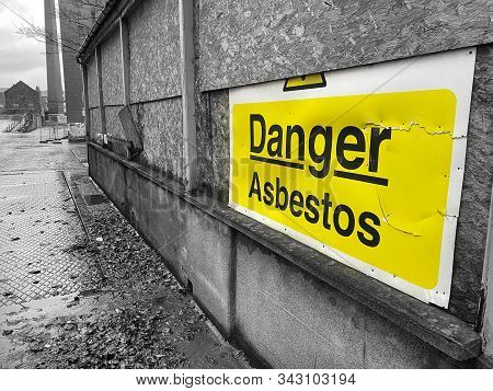 Asbestos Danger Sign At Building Construction Site Refurbishment Of Old Building
