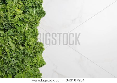 Free Space With Kale On White Background. Top View, Flat Lay Copy Space, Concept Of Raw Healthy Vega