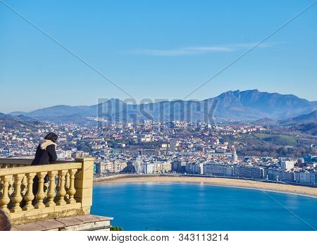 San Sebastian, Spain - December 30, 2019. Tourist On The Balcony Of The Monte Igueldo With The Conch