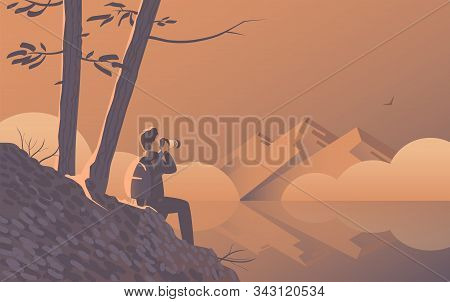 A Man Travels With A Camera. Sits On The Shore Of A Wild Lake Under The Trees. In The Distance Are B