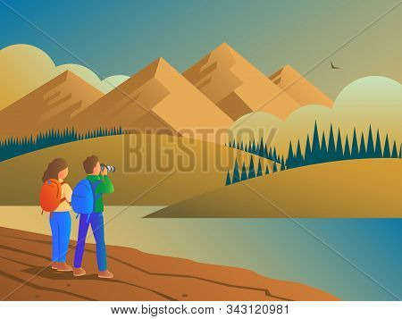 A Man And A Woman Travel In The Wild With A Camera. Evening Wildlife Landscape With Forests, Hills A