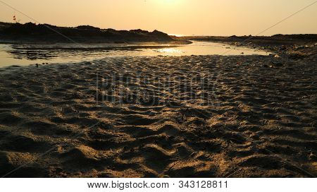 Sunset At The Mouth Of A Receding River, The Texture Of The River Estuary