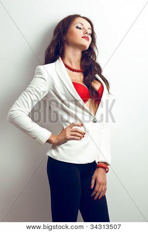 beautiful woman standing near white wall