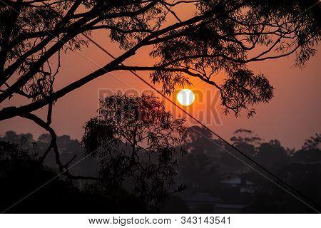 Sunset Glowing In Vivid Orange Due To Smoke Haze From Bush Fires In Australia