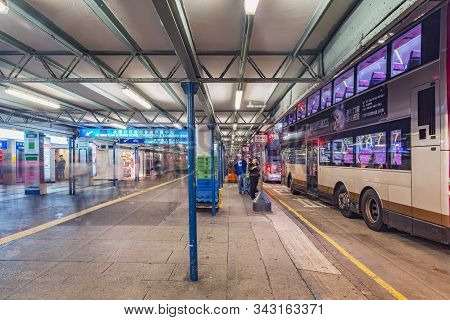 Kowloon, Hong Kong - December 11, 2016: Buses Stand By The Platforms Before Departure.