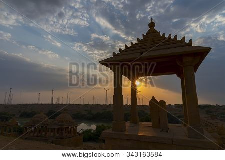 Silhouette Of Bada Bagh Or Barabagh, With Setting Sun, Is A Garden Complex In Jaisalmer, Rajasthan,