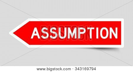Red Color Arrow Sticker With Word Assumption On Gray Background