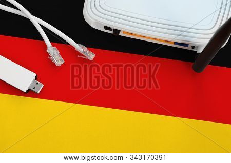 Germany Flag Depicted On Table With Internet Rj45 Cable, Wireless Usb Wifi Adapter And Router. Inter