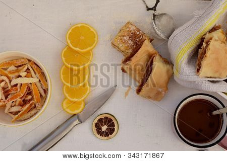 Apple And Orange Strudel At Light Wooden Background/ Closeup Still Life Food Photography/ Flatware F
