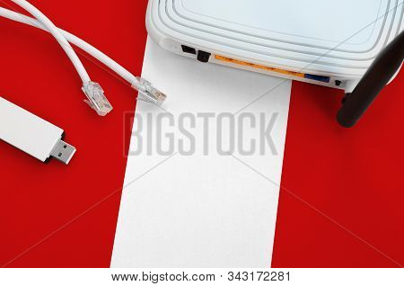 Peru Flag Depicted On Table With Internet Rj45 Cable, Wireless Usb Wifi Adapter And Router. Internet