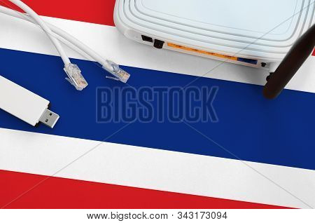 Thailand Flag Depicted On Table With Internet Rj45 Cable, Wireless Usb Wifi Adapter And Router. Inte