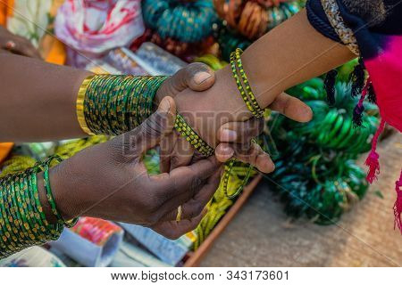 A Girl Wearing Green Color Bangles On The Street
