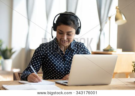 Indian Girl Student Wear Headset Study Online Teacher Write Notes