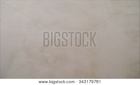 Abstract Background Of White Plastered Wall Texture, Close Up. Wet Stucco Backdrop With Free Space F