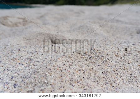 Close Up Of White Silica Sand Texture. Summer Beach Holiday Nature Texture