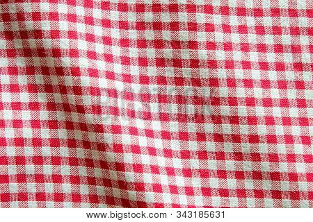 Top View Of Red And White Gingham Tablecloth Table Cover In The Restaurant. Napkin On Food Table. Fa