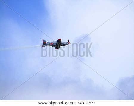 Plane PZL-130 Orlik in the air during airshow