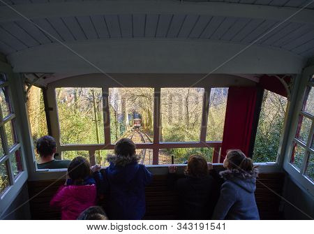 San Sebastian, Spain - December 30, 2019. Tourists On The Funicular, The Touristic Transport To The