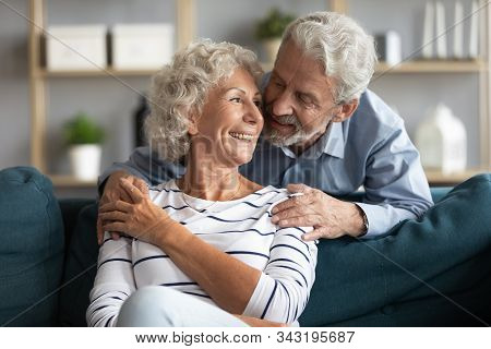 Happy Married Elderly Couple Enjoy Pleasant Time Together Indoors
