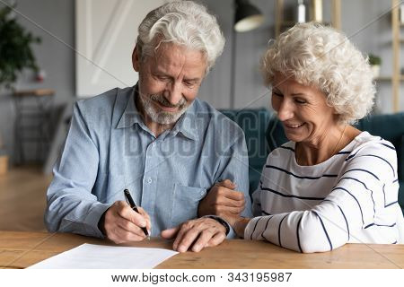 60s Elderly Spouses At Lawyer Office Sign Marriage Contract