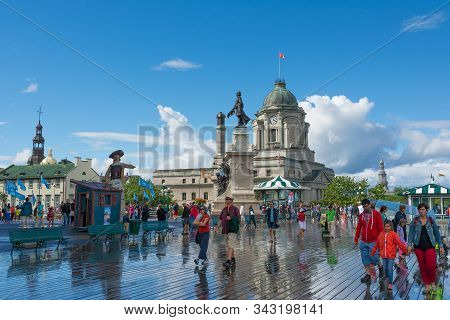 Quebec City, Canada - August 6, 2015:people Stroll On The Dufferin Terrace With The Famouse Frontena