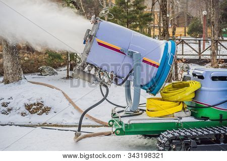 Snowmaking Or Cannon At The Park. Snow Machine Produce Snow For Ski Resort. Snow Cannon During Snowm