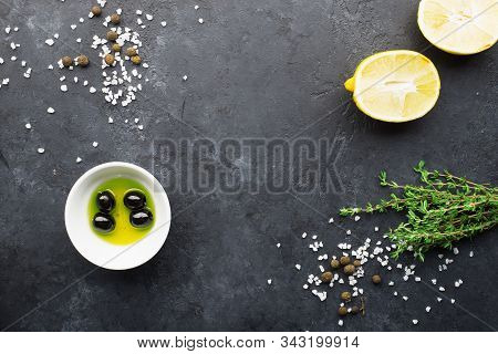 Black Food Frame Background With Fresh Aromatic Herbs And Spices, Copy Space, Top View. Allspice, Th