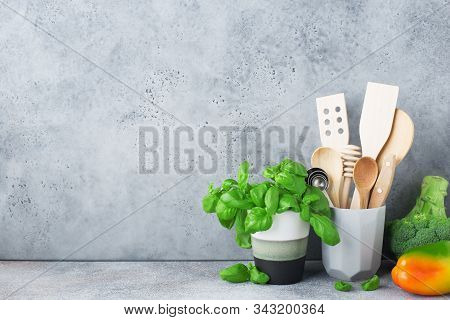 Simple Minimalist Kitchen Shelf. Cutlery, Kitchen Tools, Greens In A Glass, Fruits On A Light Backgr