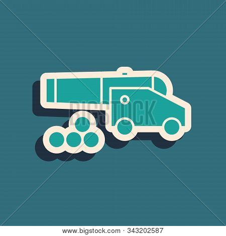 Green Cannon With Cannonballs Icon Isolated On Blue Background. Medieval Weapons. Long Shadow Style.