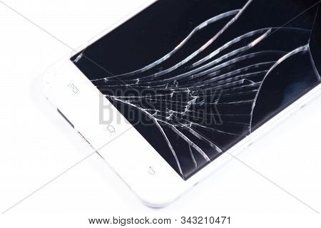 White Phone With A Broken Screen On A White Background.