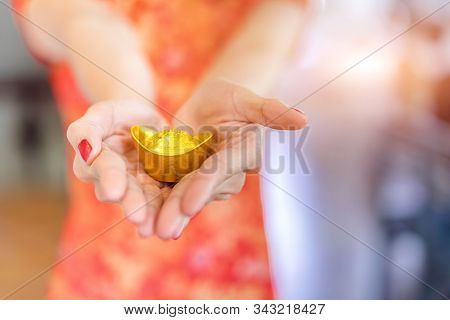 Hands Of Chinese Woman Wearing A Qipao Dress Traditional Or Cheongsam Giving Traditional Chinese Anc