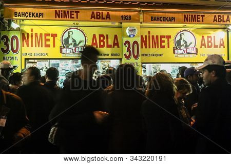 Istanbul, Turkey - December 24, 2009: Crowd Of People Queueing In Front Of A Nimet Abla Lottery Kios