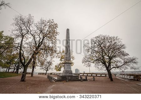 Brno, Czechia - November 3, 2019: Obelisk Of Denisove Sady Gardens, Seen During A Cold And Cloudy Ra