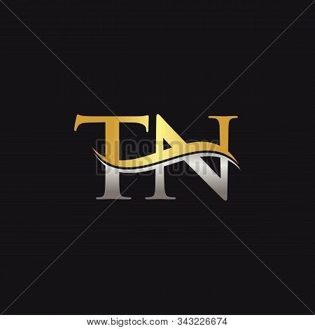 Gold And Silver Letter Tn Logo Design With Black Background. Tn Letter Logo Design