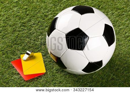 Soccer Ball With Referee Yellow And Red Cards And Chrome Whistle On Grass Background - Penalty, Foul