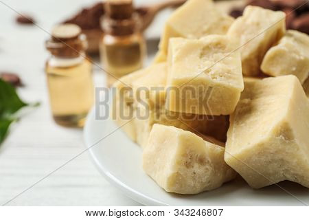 Organic Cocoa Butter On Wooden Table, Closeup