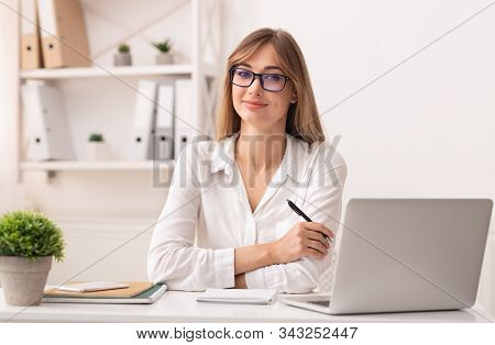 Successful Businesswoman. Confident Entrepreneur Lady Sitting At Laptop Smiling At Camera Working In