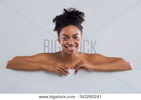 Bust Of Smiling Beautiful Black Nude Girl Posing Over Grey Background, Close Up, Spa, Beauty Salon C