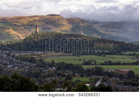 View Of The National Wallace Monument And Surroundings In Stirling, Scotland. The Tower Standing On