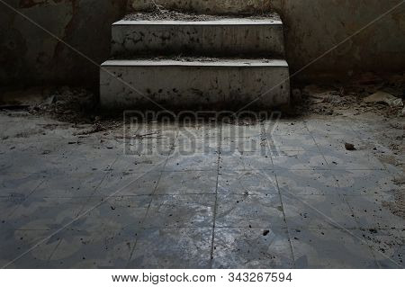 Dusty Steps And Dirty Tiled Floor In Abandoned Interior.