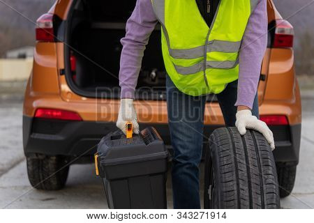 Concept Of Wearing A High-visibility Or Hi-vis Vest, During A Problem With A Car On The Road