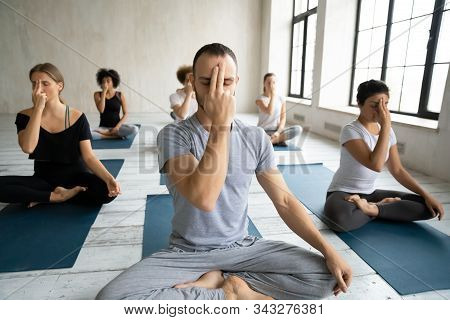 Diverse People Doing Alternate Nostril Breathing Exercise, Practicing Yoga