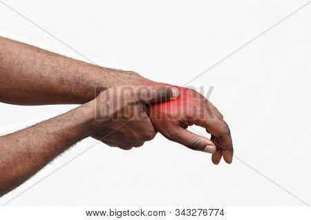 Close Up Of Afro Man Massaging His Highlighted Hand, Osteoarthritis Concept