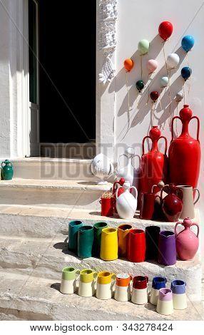 Pottery Shop In Locorotondo Town, Italy, Region Of Apulia, Adriatic Sea - Colorful Pots And Souvenir