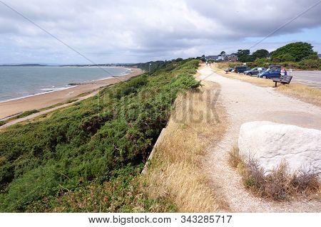 Summer Beach Scene In Christchurch In South Coast Of England