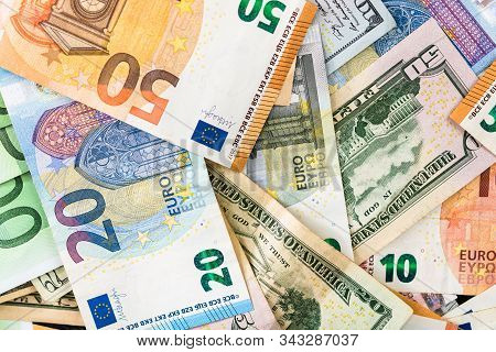 World Money Concept, Detail On Euro And Us Dollar Banknotes, Euro And Us Currency Background, Inflat