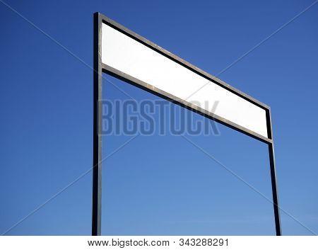 Blank Rectangular Signboard On Blue Sky Background.