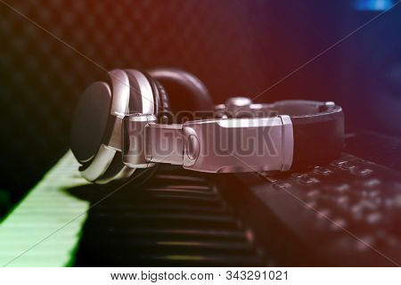 Piano Keyboard With Headphones For Music, Headphones On Piano Keyboard, Close Up,headphones On Elect