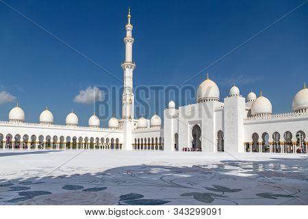 Abu Dhabi, Uae - December 31, 2019: Sheikh Zayed Grand Mosque In Abu Dhabi During Bright Day In Abu
