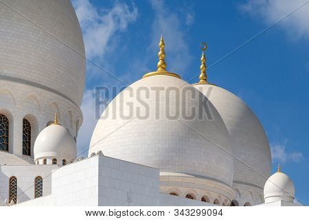 Abu Dhabi, Uae - December 31, 2019: Closeup Of Domes Of The Sheikh Zayed Grand Mosque Against Blue S